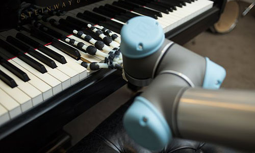 A robotic hand playing the piano